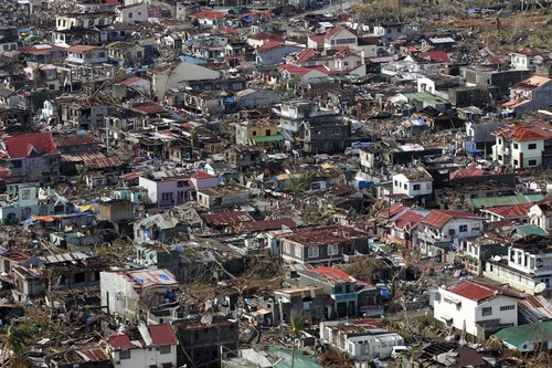 An aerial view shows the destruction left from Typhoon Haiyan in the coastal town of Tanawan, central Philippines, Wednesday, Nov. 13, 2013. Typhoon Haiyan, one of the strongest storms on record, slammed into six central Philippine islands on Friday leaving a wide swath of destruction and thousands of people dead. (AP Photo/Wally Santana)