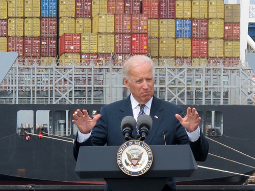 FILE - In this Monday, Sept. 9, 2013, file photo, cargo is unloaded from a vessel at the Port of Baltimore as Vice President Joe Biden speaks. The government reports on the U.S. trade deficit for September on Thursday, Nov. 14, 2013. (AP Photo/Brian Witte)