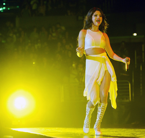 Selena Gomez performs in concert at the Staples Center on Wednesday, Nov. 6, 2013 in Los Angeles. (Photo by Chris Pizzello/Invision/AP)