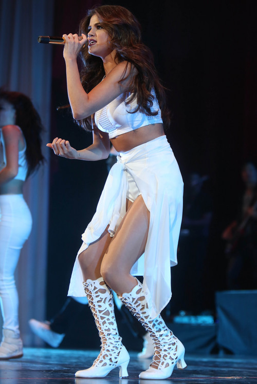 Selena Gomez performs in concert at the American Airlines Center on Sunday, Nov. 3, 2013 in Dallas. (Photo by Mike Fuentes/Invision/AP)