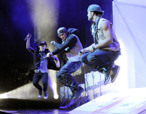 Keaton Stromberg, left, Wesley Stromberg, center, and Drew Chadwick of Emblem3 perform in concert at the Staples Center on Wednesday, Nov. 6, 2013 in Los Angeles. (Photo by Chris Pizzello/Invision/AP)