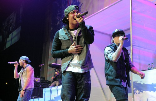 Drew Chadwick, left, Wesley Stromberg, center, and Keaton Stromberg of Emblem3 perform in concert at the Staples Center on Wednesday, Nov. 6, 2013 in Los Angeles. (Photo by Chris Pizzello/Invision/AP)