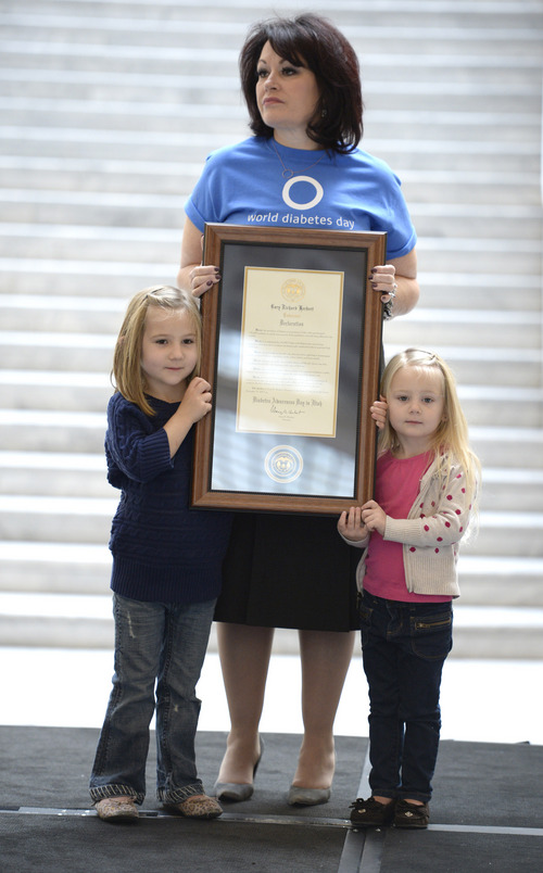 Rick Egan  | The Salt Lake Tribune   Caidence Rideout, 5, and her sister Jordyn Rideout 3, hold the governor's proclamation along with Laura Western, executive director of the Juvenile Diabetes Research Foundation, Utah chapter at the Utah State Capitol, Thursday, Nov. 14, 2013. The Juvenile Diabetes Research Foundation (JDRF), American Diabetes Association (ADA), held a press conference to warn Utah legislators and the community about the accelerating rate of diabetes today.