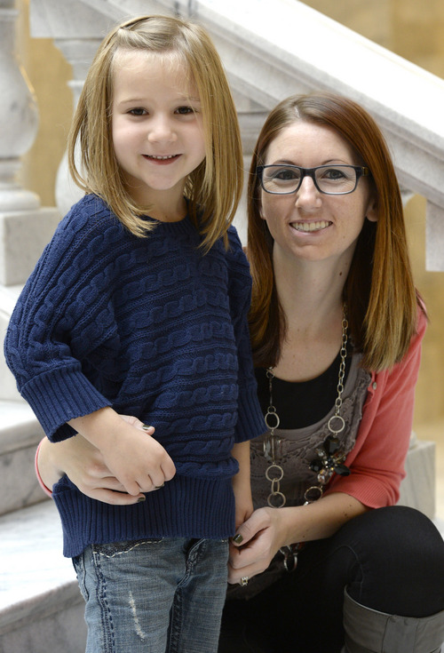 "Rick Egan  | The Salt Lake Tribune   Michelle Rideout and her daughter Caidence 5,  were featured in the documentary ""Sugar Babies""  that screened at the Utah State Capitol, Thursday, Nov. 14, 2013. The Juvenile Diabetes Research Foundation (JDRF), American Diabetes Association (ADA), held a press conference to warn Utah legislators and the community about the accelerating rate of diabetes today."