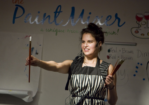 Keith Johnson | The Salt Lake Tribune  Paint Mixer instructor Brenda Hattingh shows participants the various brush sizes before they follow along as she paints a wine bottle at their Sugar House location in Salt Lake City, November 7, 2013. Paint Mixer gives participants the opportunity to enjoy a glass of wine or beer, and follow an instructor step-by-step to recreate a featured painting. Paint Mixer has two locations, Sugar House and Park City.