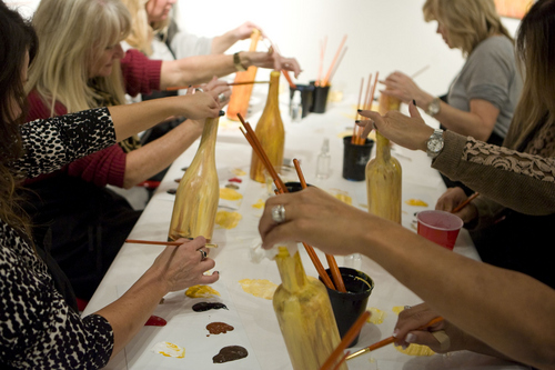 Keith Johnson   The Salt Lake Tribune  Participants paint wine bottles at Paint Mixer in Salt Lake City, November 7, 2013. Paint Mixer gives participants the opportunity to enjoy a glass of wine or beer, and follow an instructor step-by-step to recreate a featured painting. Paint Mixer has two locations, Sugar House and Park City.