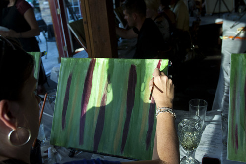 Chris Detrick  |  The Salt Lake Tribune Donyiel Wade, of Tooele, paints during The Paint Mixer party at Tin Angel Cafe Tuesday June 18, 2013.