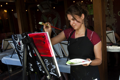 Chris Detrick     The Salt Lake Tribune Brenda Hattingh teaches a painting lesson during The Paint Mixer party at Tin Angel Cafe Tuesday June 18, 2013.
