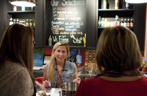 Keith Johnson   The Salt Lake Tribune  Paint Mixer manager Kelly Buskirk takes a drink order from Paige Mabbutt (right) and April Pond at Paint Mixer in Salt Lake City, November 7, 2013. Paint Mixer gives participants the opportunity to enjoy a glass of wine or beer, and follow an instructor step-by-step to recreate a featured painting. Paint Mixer has two locations, Sugar House and Park City.