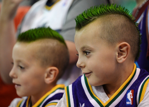 Steve Griffin  |  The Salt Lake Tribune   Twins Treyven and Keltic Parker, age 6, of Lehi, wait for the Jazz to come out of the locker room before the start of their game against the New Orleans Pelicans at EnergySolutions Arena in Salt Lake City, Utah Thursday, November 14, 2013.