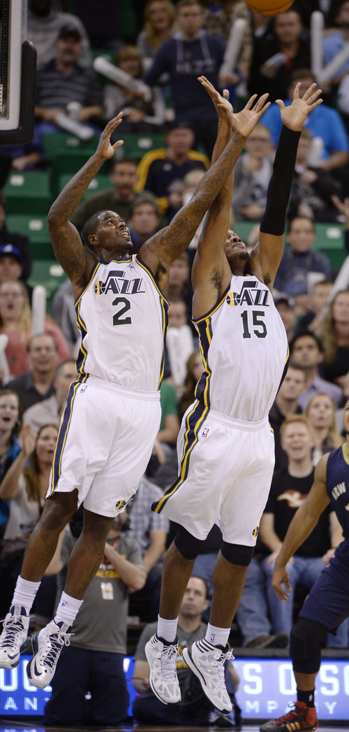 Steve Griffin  |  The Salt Lake Tribune   Utah Jazz power forward Marvin Williams #2 and Utah Jazz power forward Derrick Favors #15 both jump for a rebound during second half action in the Jazz versus New Orleans Pelicans basketball game at EnergySolutions Arena in Salt Lake City, Utah Thursday, November 14, 2013.