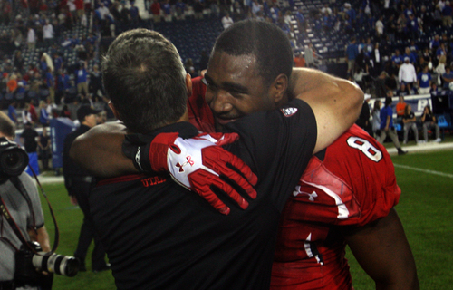 Rick Egan  | The Salt Lake Tribune   Utah Utes head coach Kyle Whittingham congratulates defensive end Nate Orchard (8) BYU 20-13, at Lavell Edwards Stadium, Saturday, September 21, 2013.