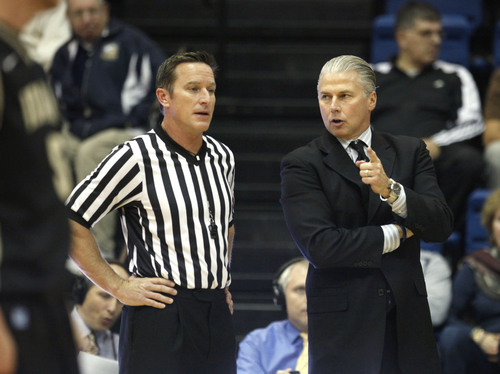 In this photo taken Saturday, Dec. 3, 2011, UC Davis head coach Jim Les talks with official Donn Berhdal during an NCAA basketball game against Idaho, in Davis, Calif. Neither Jim Les nor his son, Tyler, could have envisioned father following son across the country to UC Davis, where Tyler is a sophomore guard and his dad is the first-year coach. Tyler is one of three players on the team whose fathers played in the NBA. (AP Photo/Rich Pedroncelli)