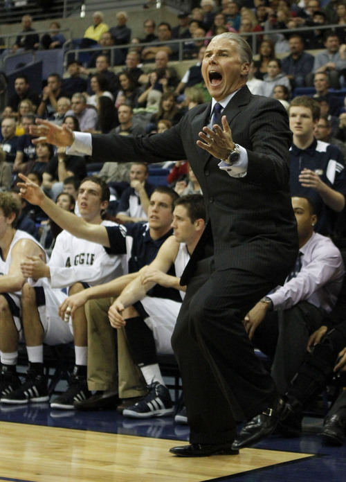 U.C. Davis head coach Jim Les questions an official's call during the first half against Stanford in an NCAA college basketball game in Davis, Calif., Friday, Nov. 18, 2011. Stanford won 70-49. (AP Photo/Rich Pedroncelli