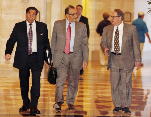 MLB executive vice president Joe Torre, along with  Chicago White Sox owner Jerry Reinsdorf, right, and assistant Dennis Gilbert, left, head for morning meetings at baseball's general managers' meetings Thursday, Nov. 14, 2013, in Orlando, Fla. (AP Photo/Reinhold Matay)