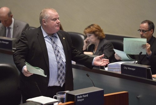"""Mayor Rob Ford speaks at city council in Toronto on Wednesday, Nov. 13, 2013. Almost every member of Toronto's City Council stood up and asked Mayor Rob Ford to take a leave of absence during a city council meeting Wednesday after he admitted smoking crack last week.""""Together we stand to ask you to step aside and take a leave of absence,"""" Councilor Jaye Robinson said, reading open letter to Ford in City Council. The council voted 41-2 to accept the letter Wednesday, with the embattled mayor casting one of the opposing votes. (AP Photo/The Canadian Press, Nathan Denette)"""