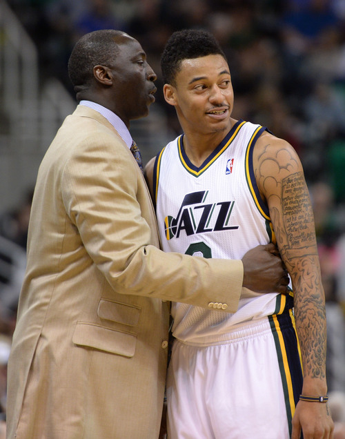 Steve Griffin  |  The Salt Lake Tribune   Utah Jazz head coach Tyrone Corbin gives Utah Jazz point guard Diante Garrett #8 a hug as he gives him some coaching advice during second half action in the Jazz versus New Orleans Pelicans basketball game at EnergySolutions Arena in Salt Lake City, Utah Thursday, November 14, 2013.