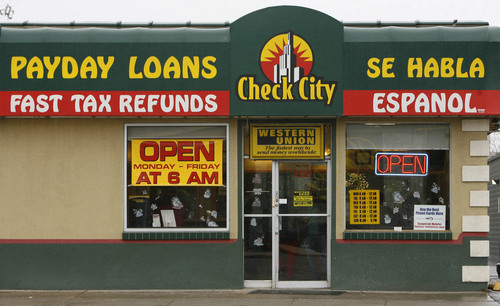 Tribune file photo Payday lenders in Utah offer loans with an average interest rate of more than 400 percent.
