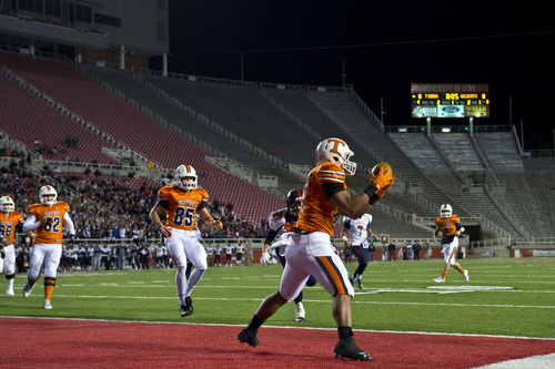 Chris Detrick     The Salt Lake Tribune Timpview's Kendall Tu'ua (27) makes a touchdown catch during the game at Rice-Eccles Stadium Thursday November 14, 2013. Timpview is winning the game 23-6 at halftime.
