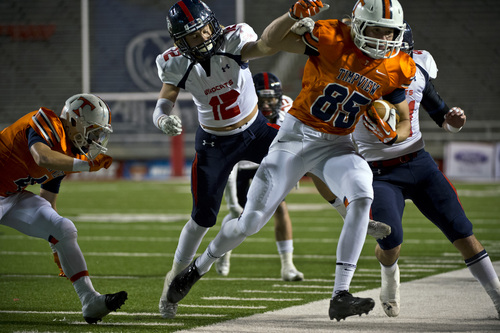 Chris Detrick     The Salt Lake Tribune Timpview's Knight Woodward (85) is knocked out of bounds by Woods Cross's Braxton Gunther (12) during the game at Rice-Eccles Stadium Thursday November 14, 2013. Timpview is winning the game 23-6 at halftime.