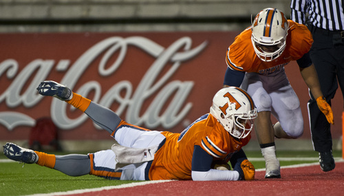 Chris Detrick     The Salt Lake Tribune Timpview's Gabe Reid (90) dives on the ball for a touchdown after a wild punt snap by Woods Cross during the game at Rice-Eccles Stadium Thursday November 14, 2013. Timpview is winning the game 23-6 at halftime.