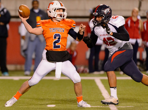 Trent Nelson     The Salt Lake Tribune Timpview quarterback Britain Covey makes a pass just before being hit by Woods Cross's Deion Saumalu as Woods Cross faces Timpview High School in the 4A State Semifinals in Salt Lake City, Thursday November 14, 2013.