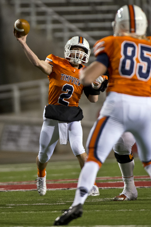 Chris Detrick     The Salt Lake Tribune Timpview's Britain Covey (2) passes the ball during the game at Rice-Eccles Stadium Thursday November 14, 2013. Timpview defeated Woods Cross 37-6.