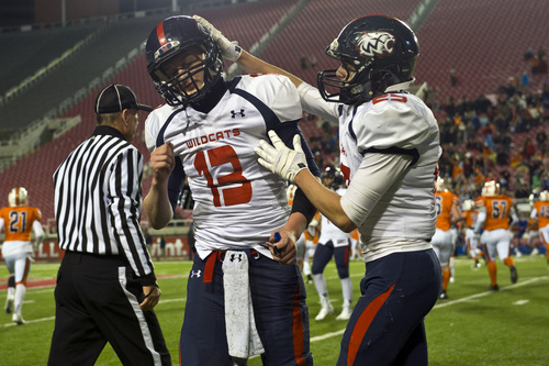 Chris Detrick     The Salt Lake Tribune Woods Cross's Luke Jowers (13) and Woods Cross's Brandon Kinsey (25) after the game at Rice-Eccles Stadium Thursday November 14, 2013. Timpview defeated Woods Cross 37-6.