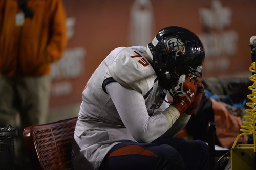 Chris Detrick     The Salt Lake Tribune Woods Cross's Siale Mausia (73) sits on the bench during the game at Rice-Eccles Stadium Thursday November 14, 2013. Timpview defeated Woods Cross 37-6.