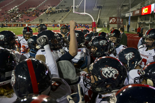 Chris Detrick     The Salt Lake Tribune Members of the Woods Cross football team get pumped up before the game at Rice-Eccles Stadium Thursday November 14, 2013. Timpview is winning the game 23-6 at halftime.