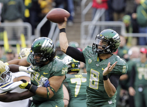 Oregon quarterback Marcus Mariota passes during the first half of an NCAA college football game against UCLA in Eugene, Ore., Saturday, Oct. 26, 2013. (AP Photo/Don Ryan)