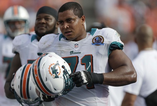 FILE - In this Dec. 16, 2012 file photo, Miami Dolphins tackle Jonathan Martin (71) watches from the sidelines during the second half of an NFL football game against the Jacksonville Jaguars, in Miami. In the stadium program sold at the Dolphins' game on Halloween, Richie Incognito was asked who's the easiest teammate to scare. His answer: Jonathan Martin.  The troubled, troubling relationship between the two offensive linemen took an ominous turn Monday, Nov. 4, 2013, with fresh revelations: Incognito sent text messages to his teammate that were racist and threatening, two people familiar with the situation said. (AP Photo/Wilfredo Lee, File)