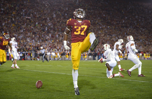 Mark J. Terrill | The  Southern California running back Javorius Allen celebrates a touchdown during the first half of an NCAA college football game against Stanford, Saturday, Nov. 16, 2013, in Los Angeles. (AP Photo/Mark J. Terrill)