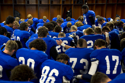 Chris Detrick  |  The Salt Lake Tribune Bingham's Sione Finefeuiaki (44) leads the team in prayer before the 5A semifinal game against Lone Peak at Rice-Eccles Stadium Friday November 15, 2013.