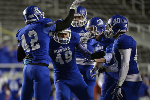 Chris Detrick  |  The Salt Lake Tribune Bingham's Langi Tuifua (49) celebrates with his teammates after recovering the ball on a bad Lone Peak snap during the 5A semifinal game at Rice-Eccles Stadium Friday November 15, 2013. Bingham is winning the game 35-6 at halftime.