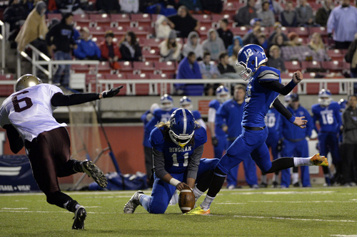 Chris Detrick  |  The Salt Lake Tribune Bingham's Chayden Johnston (12) kicks a point after touchdown during the 5A semifinal game at Rice-Eccles Stadium Friday November 15, 2013. Bingham is winning the game 35-6 at halftime.