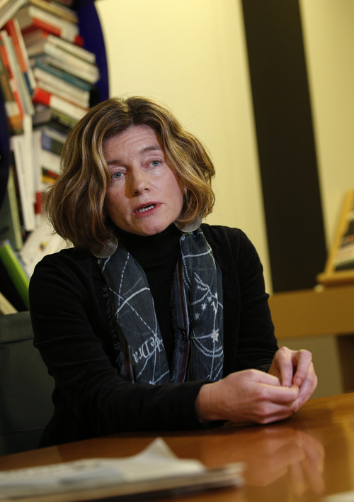 """In this photo taken Tuesday, Nov. 12, 2013, chief editor of Le Monde newspaper Natalie Nougayrede, speaks during an interview with The Associated Press, in Paris, Tuesday. As revelations about the staggering scope of the NSA's surveillance have cascaded around the world, newsroom leaders weighed ethical decisions over how much they should reveal about intelligence. Nougayrede said the paper has not come under pressure from French authorities to turn over documents or withhold information but is keeping the documents it obtained """"in a safe place"""" that she would not describe. (AP Photo/Christophe Ena)"""