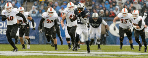 Trent Nelson  |  The Salt Lake Tribune Brigham Young Cougars running back Jamaal Williams (21) runs for a tochdown as BYU hosts Idaho State, college football at LaVell Edwards Stadium in Provo, Saturday November 16, 2013.