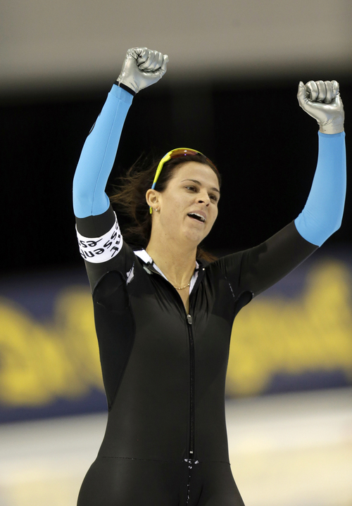 Brittany Bowe, of the United States, celebrates after the women's 1000-meter competition at the World Cup speedskating event Sunday, Nov. 17, 2013, in Kearns, Utah. Bowe came in first place.  (AP Photo/Rick Bowmer)