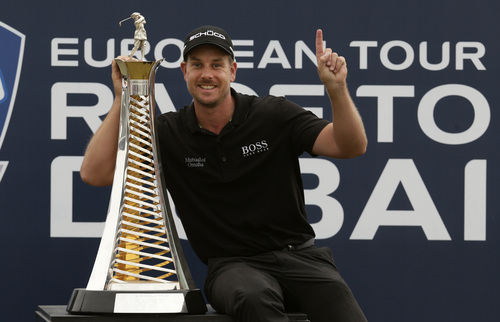 Hassan Ammar   The Associated Press Henrik Stenson from Sweden poses for picture next to the European tour race trophy after the final round of DP World Golf Championship, in Dubai, United Arab Emirates, Sunday, Nov. 17, 2013. (AP Photo/Hassan Ammar)