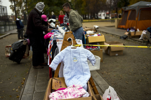"""Chris Detrick       The Salt Lake Tribune Everything from baby """"onesies"""" to parkas were free for the picking by Salt Lake City's homeless people on Saturday when The Legacy Initiative, a nonprofit group, held its third """"Street Boutique"""" in Pioneer Park in downtown Salt Lake City."""
