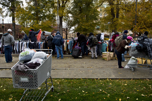 """Chris Detrick     The Salt Lake Tribune Shopping carts were filled with clothing by homeless people who took advantage of a """"Street Boutique"""" organized by a non profit group, The Legacy Initiative,"""" to """"give hope to those whose situation seems bleak."""" Nonprofit volunteers gave out clothing, burritos and bottled water at Pioneer Park and in the downtown neighborhoods frequented by the indigent."""