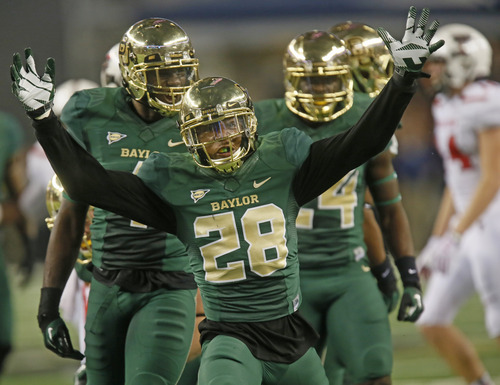 Baylor Bears safety Orion Stewart (28) celebrates a defensive stop in the second quarter during the Texas Tech University Red Raiders vs. the Baylor University Bears NCAA football game  in Arlington, TX on Saturday, Nov. 16, 2013. (AP Photo/Louis DeLuca/Dallas Morning News)