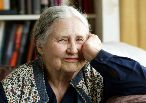 "FILE - In this April 17, 2006 file photo, Writer Doris Lessing, 86, sits in her home in north London. Doris Lessing, the free-thinking, world-traveling, often-polarizing writer of ""The Golden Notebook"" and dozens of other novels that reflected her own improbable journey across the former British empire, has died, early Sunday, Nov. 17, 2013.  She was 94. The author of more than 50 works of fiction, nonfiction and poetry, Lessing explored topics ranging from colonial Africa to dystopian Britain, from the mystery of being female to the unknown worlds of science fiction.  (AP Photo/Martin Cleaver, File)"