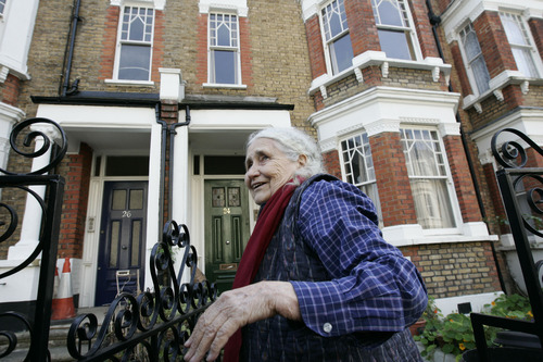 "FILE - In this Thursday, Oct. 11, 2007 file photo, British writer Doris Lessing, winner of the 2007 Nobel Prize in literature, smiles as she talks to members of the media, shortly after the announcement of the award, outside her home in north London. Doris Lessing, the free-thinking, world-traveling, often-polarizing writer of ""The Golden Notebook"" and dozens of other novels that reflected her own improbable journey across the former British empire, has died, early Sunday, Nov. 17, 2013.  She was 94. The author of more than 50 works of fiction, nonfiction and poetry, Lessing explored topics ranging from colonial Africa to dystopian Britain, from the mystery of being female to the unknown worlds of science fiction.  (AP Photo/Lefteris Pitarakis, File)"