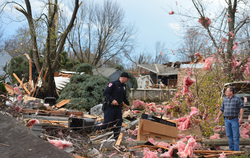 A tornado left a path of devastation through the north end of Pekin, Il.,Sunday, Nov. 17, 2013. Intense thunderstorms and tornadoes swept across the Midwest on Sunday, causing extensive damage in several central Illinois communities while sending people to their basements for shelter. (AP Photo/Journal Star, Fred Zwicky) MANDATORY CREDIT