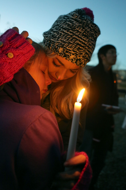 Francisco Kjolseth     The Salt Lake Tribune Kendyll Stewart, left, is comforted by Tayler Nicole, sister and stepsister to Taylor Wheeler, 12, who was found dead in a home in Daybreak on Friday. The two were surrounded by friends and family as they gathered in South Jordan at Firmont Park for a candelight vigil on Sunday, Nov. 17, 2013, in memory of Taylor and Dayton Gessell, 15, after the two were found dead in a home in Daybreak on Friday.
