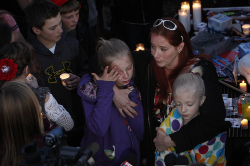Francisco Kjolseth     The Salt Lake Tribune CharlÈ Meier comforts her two daughters Kendyll Stewart, left, and Ariyl Meier as they are surrounded by people gathered in South Jordan at Firmont Park for a candelight vigil on Sunday, Nov. 17, 2013, in memory of her son Taylor Wheeler, 12, and Dayton Gessell, 15, after the two were found dead in a home in Daybreak on Friday.