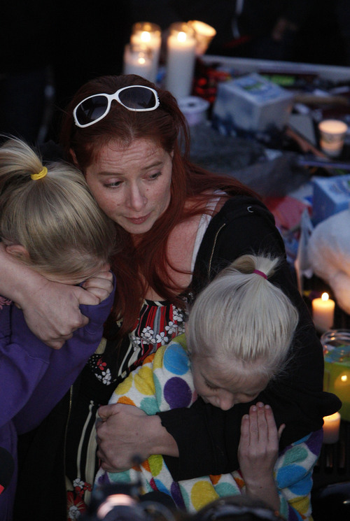 Francisco Kjolseth     The Salt Lake Tribune Charlé Meier comforts her two daughters Kendyll Stewart, left, and Ariyl Meier as they are surrounded by people gathered in South Jordan at Firmont Park for a candelight vigil on Sunday, Nov. 17, 2013, in memory of her son Taylor Wheeler, 12, and Dayton Gessell, 15, after the two were found dead in a home in Daybreak on Friday.