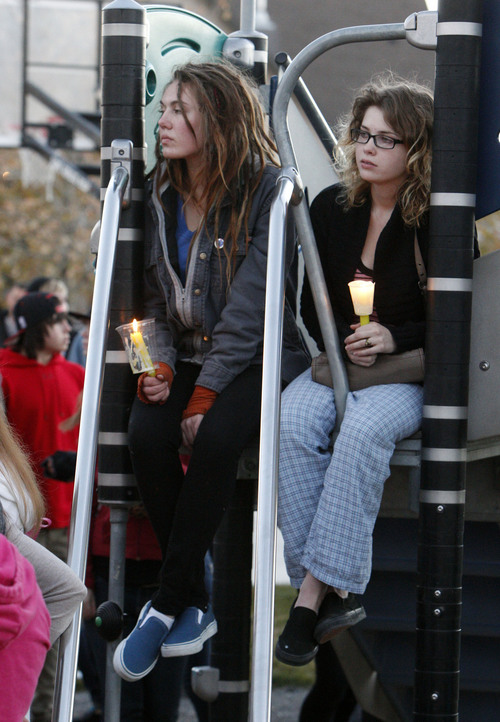 Francisco Kjolseth     The Salt Lake Tribune Jaclyn Long and Abbie Wardle gather in South Jordan at Firmont Park for a candelight vigil on Sunday, Nov. 17, 2013, in memory of Taylor Wheeler, 12, and Dayton Gessell, 15, after the two were found dead in a home in Daybreak on Friday.